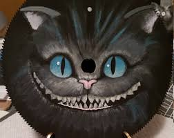 circular saw blade painting. cheshire cat from burton\u0027s alice in wonderland painted on a circular saw blade painting