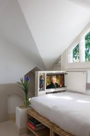 twin bed with tv cabinet in small space