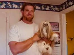 Here's young unmasked Kane looking quite happy holding a dog. :  SquaredCircle