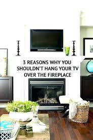 tv mounted above brick fireplace ing mounting hiding wires