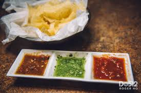 after taking our seats we were served homemade tortilla chips and abuelo s signature salsa trio which featured the esteemed salsa tropical
