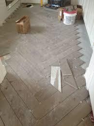 bathroom floors herringbone chevron pattern faux wood