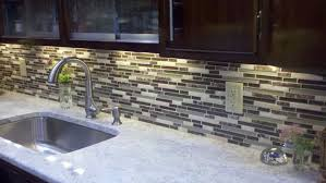 kitchen backsplash stainless steel tiles: backsplash ideas for kitchen with grey glass tile kitchen backsplash including white granite kitchen counter