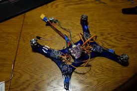 building a fpv racing drone part work in progress before we zip tie everything down i ll make sure to check that everything is working remember to cross the wires of 2 opposing esc to give counter rotation