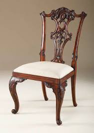 carved aged regency finished gany chippendale style side chair with woven caramel upholstery