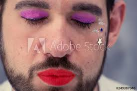 a man with make up he is red lips and beard the
