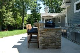 Custom Outdoor Kitchen Designs Gorgeous Long Island Outdoor Kitchen And Bar With Seating Natural Stone
