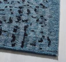 hand knotted rugs are intricately crafted by an artisan who hand knots each piece of yarn on a loom this is how traditional persian or oriental rugs are
