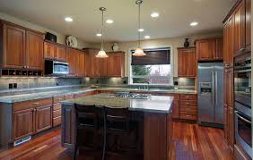 traditional kitchen with rainforest green granite countertops and cherry cabinets