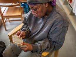 california s homeless a quiet place proof arleta taylor reads first corinthians in her pocket copy of the new testament holy bible at the sacramento public library central branch