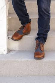 hey guy the streets in toms brogue boots for men these brown leather and grey wool boots feature a vibram sole for extra traction