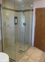 custom sized solid surface walk in shower with a frameless glass enclosure innovate building solutions solid surface wall panels