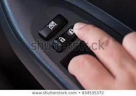 press the inside car door lock on