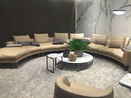 curved leather sofa and circle coffee tables