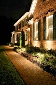 landscaping lighting ideas. 1. Dramatic Uplighting On Your Home Landscaping Lighting Ideas