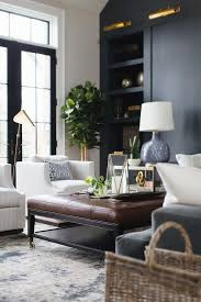 Brown And Blue Living Room Beauteous A Brown Leather Tufted Ottoman Sits On A Silver And Blue R