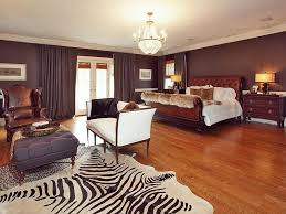 zebra print bedroom furniture. this spacious bedroom incorporates zebra print with an area rug adjacent to the sitting furniture t