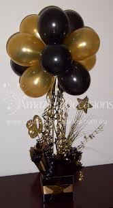 black and gold balloon centerpiece bing images graduation party centerpiecesballoon