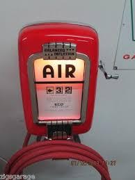 tire inflator gas station. vintage original eco air meter tireflator old service station.oil and gas pumps tire inflator station