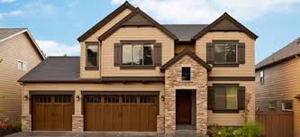 brown exterior paint color schemesRich brown trim colour accentuates the stone entryway  Benjamin