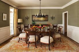 calming dining room design with grey wall and white dining chair and round shape