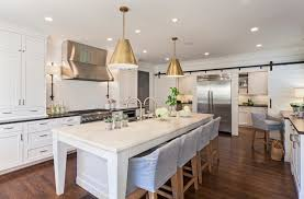 when it comes to installing a light above the dining room table the right height really depends upon the type of light you ve chosen of course if