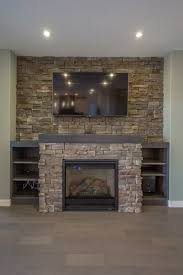 built out fireplace with stone accent around and full stone tile wall behind with half