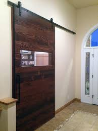 reclaimed wood door with brushed metal accents
