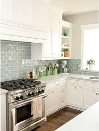 kitchen white glass backsplash. Kitchen Remodel, Blue Glass Tile Backsplash LOVE THE BACK SPLASH And Tithe White Cabinets!