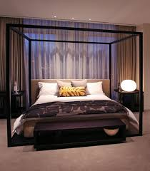 modest bedroom design with black painted wooden canopy bed and modest bedroom design with black painted wooden canopy bed and bedroom accent lighting surrounding