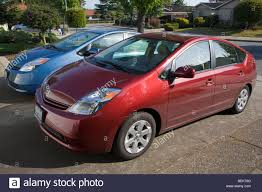 A side view of two parked Toyota Prius hybrid cars. Cupertino ...