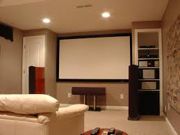home theater room design. Small Minimalist Home Theater Room Design With Low Ceiling And Light Brown Interior Color Plus Wood Sound System Storage Disc Beside Screen Floor C