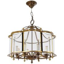 mid century brass chandelier with curved glass shade for