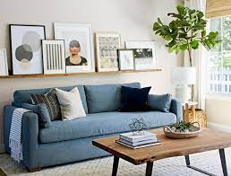 Anyone with a colorful living room should consider a macrame wall hanging for behind the sofa; How To Perfectly Style The Blank Wall Behind Your Sofa The Zhush