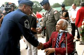 u s department of defense photo essay herbert e carter shakes hands an airman who he just gave