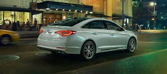 hyundai sonata 2015 white. exterior action photo of white hyundai sonata 2017 following another car at a safe distance 2015