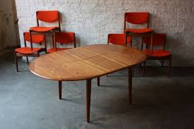 oval expandable dining table ideas with red dining room chairs
