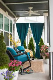 add privacy to your porch with panels of rich blue sunbrella outdoor fabric