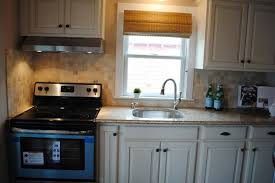 ceiling lighting fixture for kitchen sink a kitchen set with brown granite countertop white kitchen cabinets