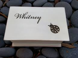 custom engraved wooden al jewelry box with a name and a ladybug on top with your choice of color and