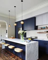 minimalist kitchen design with white marble island and blue cabinet paint using small pendant lights