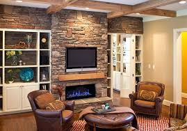 stack stone fireplaces with plasma mounted tv over fireplace mantel living room