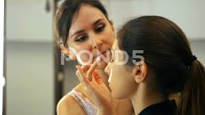video makeup artist makes models eye makeup beautiful woman applying cosmetics on 77863054