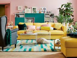 ikea white living room furniture. yellow couch with two round white coffee tables green storage cabinets and pink walls ikea living room furniture s
