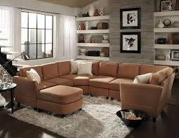 warm small living room with brown sectional