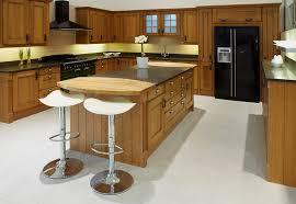 black appliance matte seamless kitchen: wood kitchen with black appliances and wood counter island