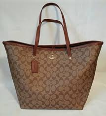Amazon.com  Coach Signature C Large Taxi Tote Khaki Saddle F34105  Shoes