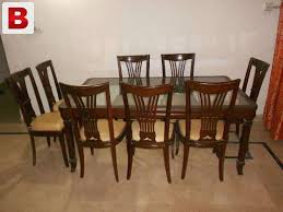 dining table and chairs for sale in karachi. pictures of dining table with 8 chairs in good condition and for sale karachi i