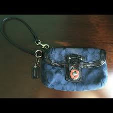 Coach wristlet with front buckle pocket