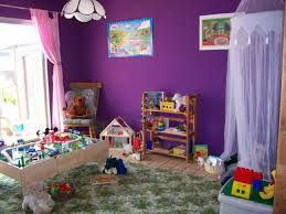 Cheerful And Cool Playroom Designs For Toddler : Wondrous Playroom Design  for Toddler with Purple Wall Painting and Pretty Pink Curtain also Wooden  Shelves ...